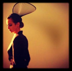 Annarose wears BOUDICCA Tuxedo with House of Flora Fan Hat.